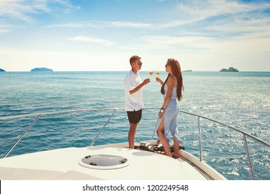 summer vacation travel, romantic couple drinking champagne on luxury yacht, sea holidays