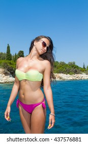 Summer vacation - young girl on a motor boat