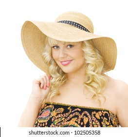 Summer vacations - beautiful blonde woman smiling and wearing straw hat and strapless dress. Isolated over white background.