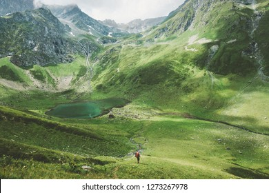 Summer vacations man traveler hiking Travel adventure active lifestyle outdoor lake and mountains wilderness nature