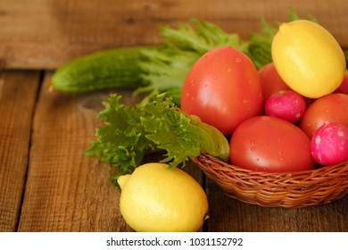 Summer vegetables and fruits on a wooden table