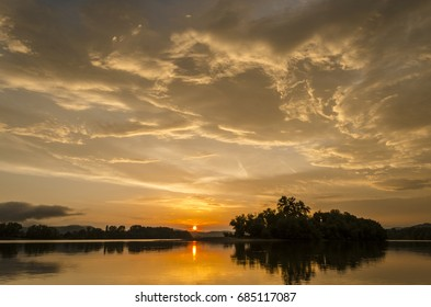Summer vibrant magnificent sunset by Danube in Hungary, island sunset outdoors
