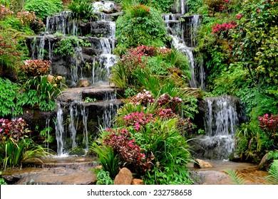Summer view of beautiful small waterfalls
