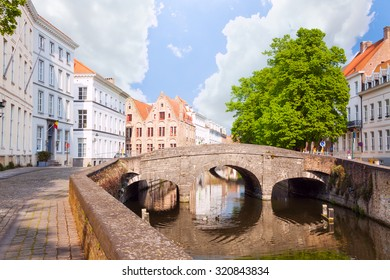 Summer view of the canal and small bridge, Bruges