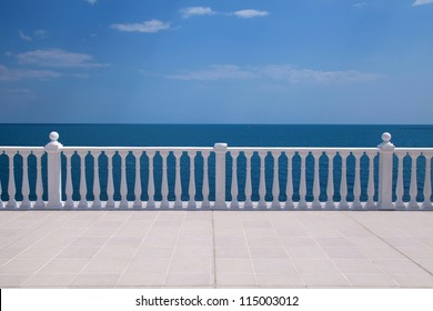 Summer view with classic white balustrade and empty terrace overlooking the sea (Italy)
