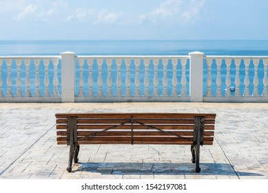 Summer view with classic white balustrade, bench and empty terrace overlooking the sea, Anapa