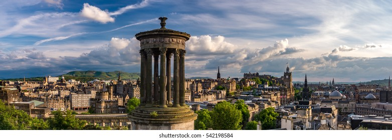 Summer view of Edinburgh's skyline with the iconic Dugald Stewart Monument in the foreground and the Edinburgh Castle at the back. Scotland, UK