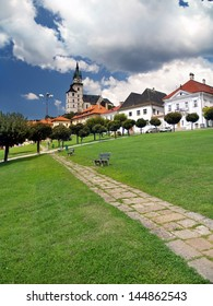 Summer view of freshly cut grass and walkway on main square of Kremnica town with towers of Kremnica castle (Mestsky hrad v Kremnici) in background. - Shutterstock ID 144862543