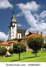 Summer view of main square of Kremnica town and Kremnica castle (Mestsky hrad v Kremnici) with church tower in background. - Shutterstock ID 144860467
