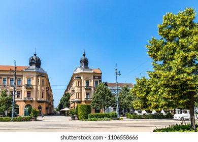 Summer view of Market Street (Hungarian: Piac utca), the major street of Debrecen city, Hungary. Blooming linden trees on the foreground
