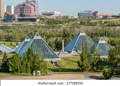 Summer view of a modern building (muttart conservatory) and its reflections, Edmonton, Alberta, Canada