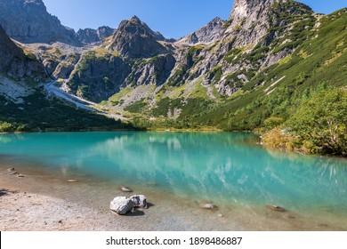 Summer view of a mountain lake Zelene pleso with nice blue water, High Tatras, Slovakia
