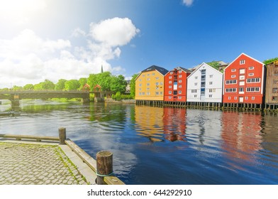 Summer view from Nidelva river on three main landmarks Trondheim, Norway