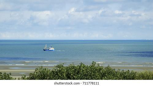 Summer view of the North Sea from the dunes in Nieuwpoort Belgium