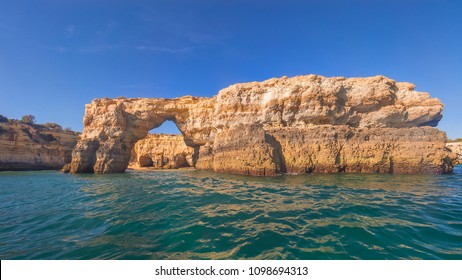 Summer - view from the ocean on the rocks, the cliffs and the caves in Benagil, Algarve, Portugal
