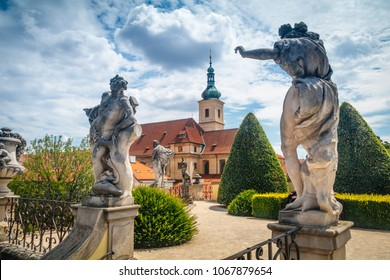 Summer view on Statues and st. Nicholas church of Vrtba garden (