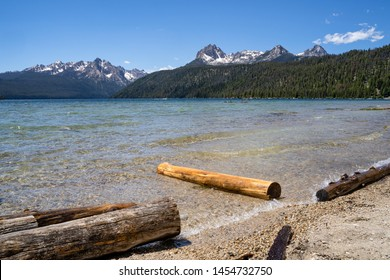 Summer view at Redfish Lake, located outside Stanley Idaho in the Sawtooth National Forest wilderness. Logs in foreground