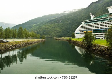 Summer view of Sognefjorden fjord, Norway. Large cruise ship in Flom port, Norway. Summer Norway landscape, Flam. Northern Europe trip concept.