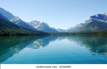 Summer view of the upper waterton lake and mountain from a crusing boat, waterton lakes national park, alberta, canada