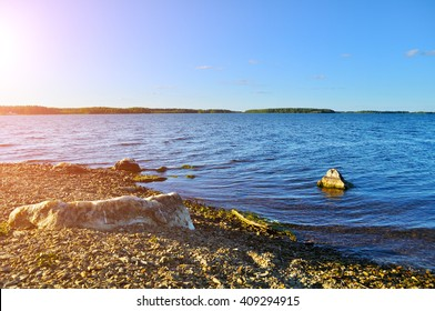 Summer water landscape - sunset over the waters of Irtyash lake in Southern Urals, Russia.