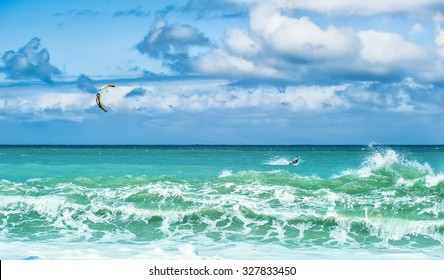 Summer watersport background of kite surfing and blue ocean water with waves and splashes
