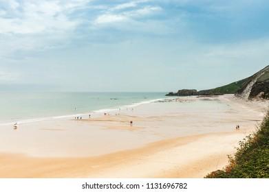 Summer waves in San Antolin beach. Cantabrian sea. Surfing in Asturias, Spain.