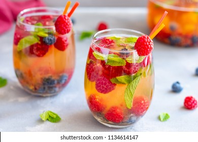 Summer white refreshing wine sangria with berries and mint.