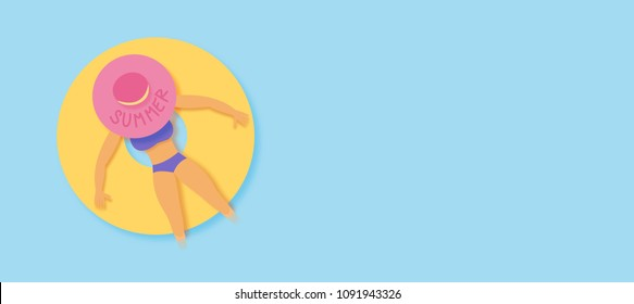 Summer woman in hat in sea on a rubber ring