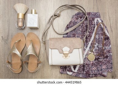 Summer woman stuff on wooden background