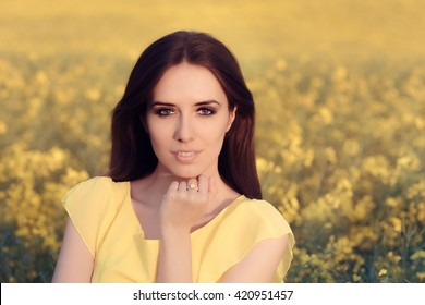 Summer Woman in Yellow Floral Landscape - Beautiful girl wearing yellow diamond ring