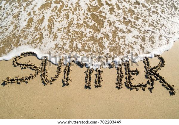 Summer word on sandy  beach