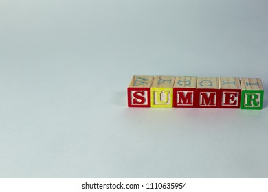 Summer word spelled with blocks