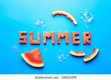 Summer word written with watermelon on blue background