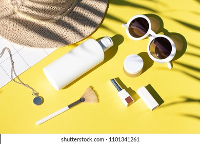 Summer yellow cosmetics flat lay with sunglasses . Top view beauty composition