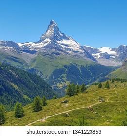 Summer in Zermatt, Switzerland. Hiking next to Sunnegga. Lovely view of the Matterhorn. Summer in the swiss alps.