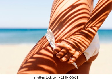 Summer,female body,bronze tan,palm tree shadow