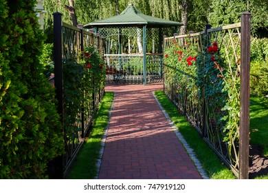 summerhouse in a landscape park in summer