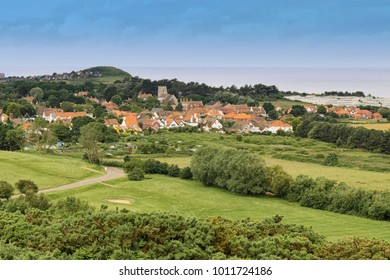 A summers day looking across the golf course and allotments towards West Runton Village, North Norfolk coast, England.