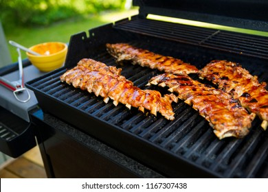 Summertime and baby back ribs on the grill