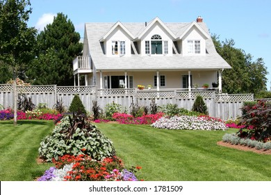 Summertime flower beds and a home.