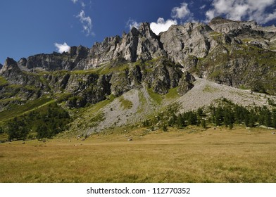 Summertime green mountain landscape in the Alps with peaks, Alpe Buscagna, Devero, Italy.