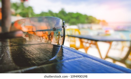 Summertime holidays background, sunglasses on beach bar table