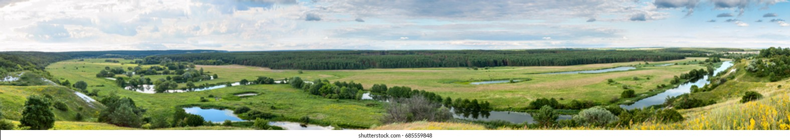 Summertime landscape banner, panorama - river valley of the Siverskyi (Seversky) Donets, the winding river over the meadows between hills and forests, border region of Ukraine near to Russia