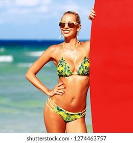 Summertime portrait of beautiful blonde woman in sunglasses