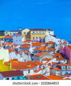 Summertime sunshine day cityscape in the Alfama - historic old district Alfama in Lisbon, Portugal.