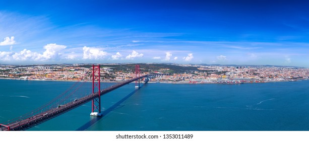 Summertime sunshine day panoramic cityscape view of Lisbon, Tagus river, Portugal.
