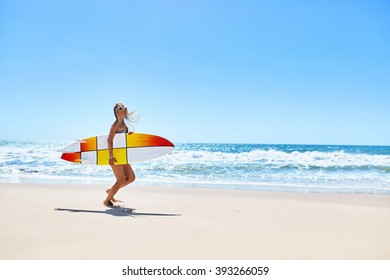 Summertime. Surfing. Summer Leisure Sport Activity. Beautiful Sporty Young Woman With Sexy Body In Bikini With Surf Board Running On Beach. Extreme Water Sports. Healthy Lifestyle. Holiday Vacations.