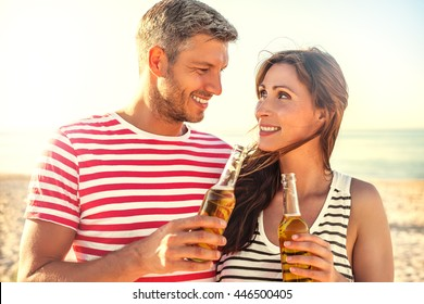 summertime travel couple enjoying sunset
