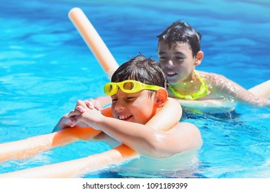 Summertime, two boys having a good time at the swimming pool.