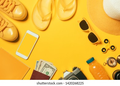 Summertime vacation accessories flat lay top view of objects prepared for holiday on the beach